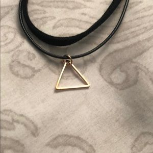 Black choker necklace with gold triangle pendant